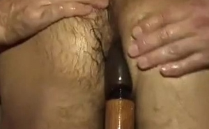Submissive stud is fucked wide of a room full of guys