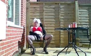 having a fag outside dressed fully