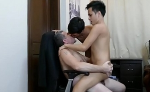Asian twinks suck off dilf boss in office