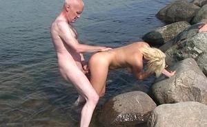 Grandpa Ulf Larsen, 54, fuck two 19-year old teen whores on public beach