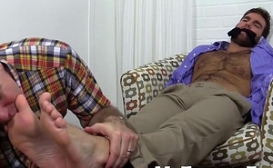 Chase is quickly gagged and booked for foot adornment