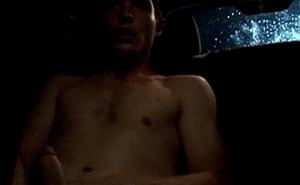 Horny amateur jerks his cock in the car and spills a load