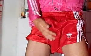Piss and cum in red-hot nylon shorts