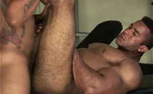 Muscled men fuck almost gym