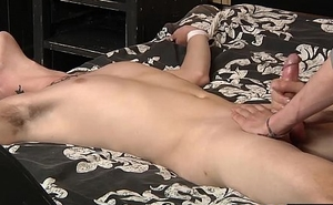Horny twink Skyler enjoys laying back being restrained