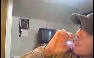 Ball capped Marlboro smoker
