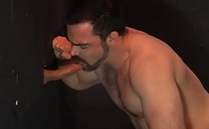 Dolan Wolf sucking on a cock at the gloryhole