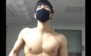 korean boy flexing his abs